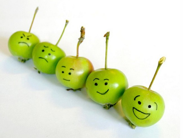 Image of apples in a row with faces from happy to sad