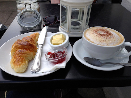 Image of coffee and pastry breakfast