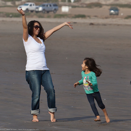 Image of mother and daughter jumping