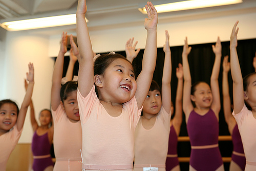 image of young girls stretching in ballet outfits