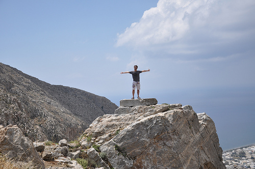Image of a man standing on a mountain top