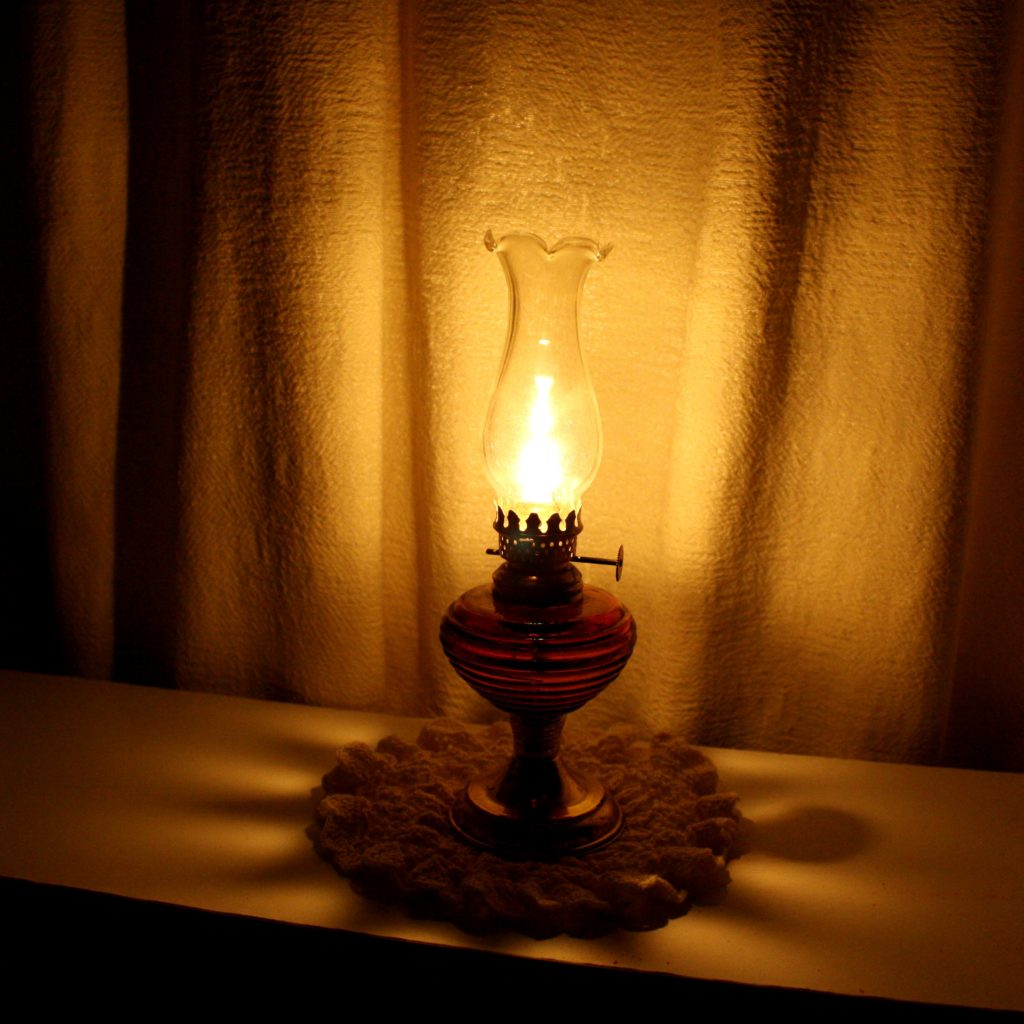 Image of an oil lamp on a table