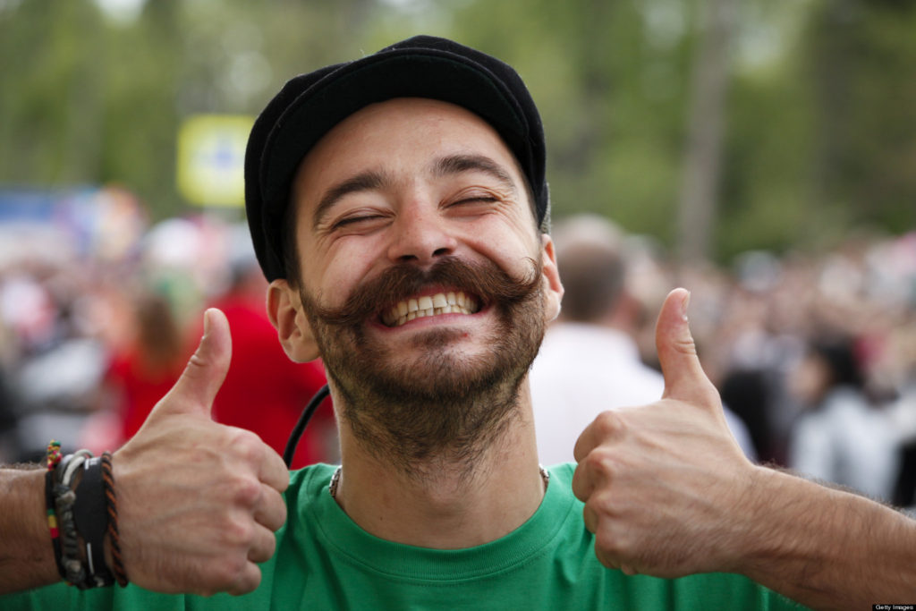 Image of smiling man with two thumbs in the air