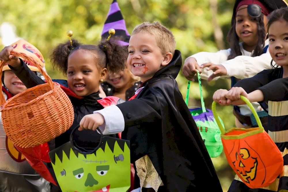 Image of kids in Halloween Costumes