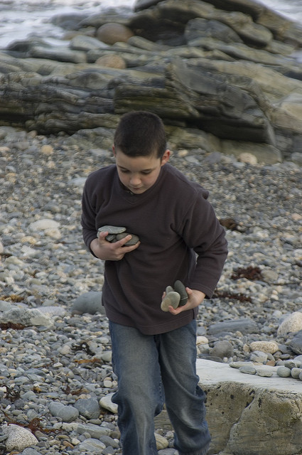 Image of a boy carrying stones