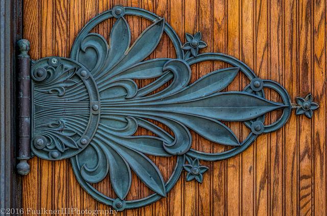 Image of an ornate door hinge