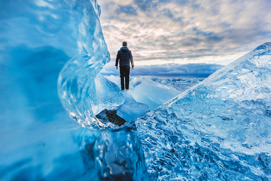 Image of man walking on ice