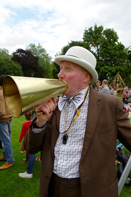 Image of an announcer with a bullhorn