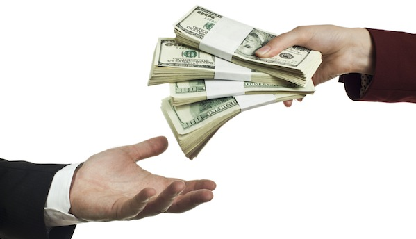 Image of hands trading money