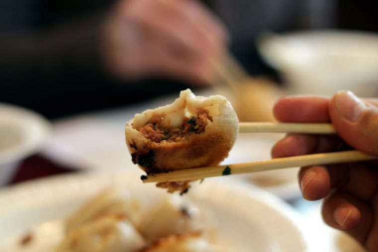 Image of a tasty bite in chopsticks
