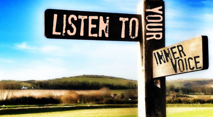 "Road sign reading ""Listen to your inner voice"""