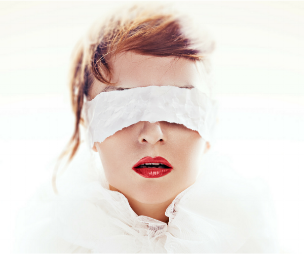 Image of a blindfolded woman