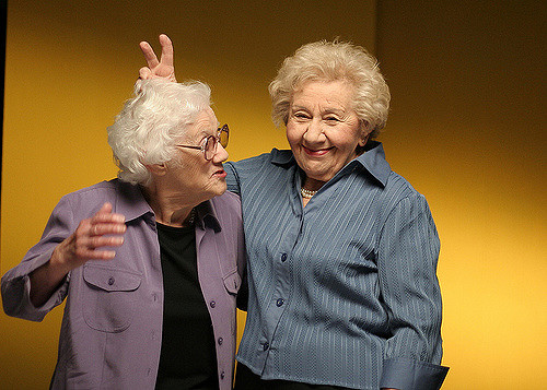 Image of two old women laughing