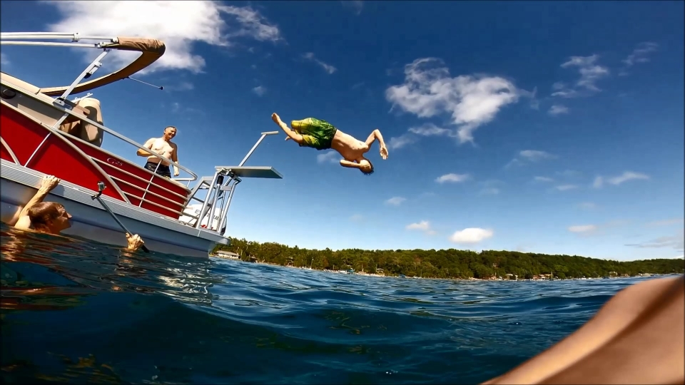 Image of boy diving from a boat