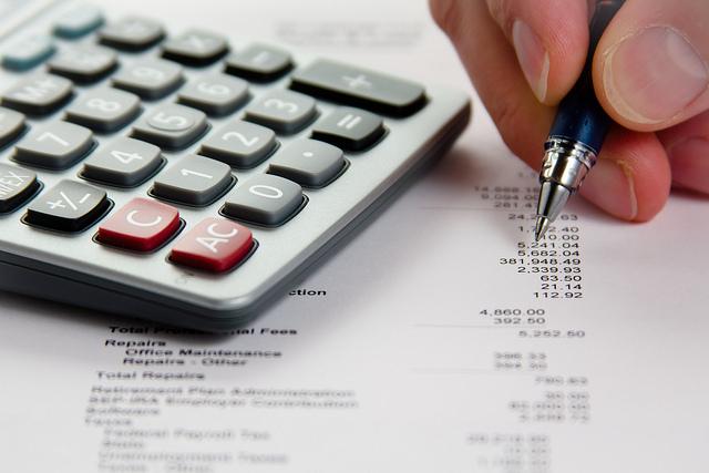 Image of a calculator and a balance sheet