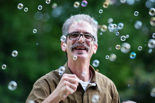 Image of a man surrounded by bubbles