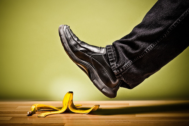 Image of a man's foot about to step on a banana peel