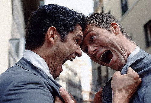 Image of 2 men screaming at each other