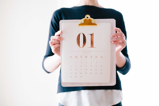 Image of a woman holding a calendar