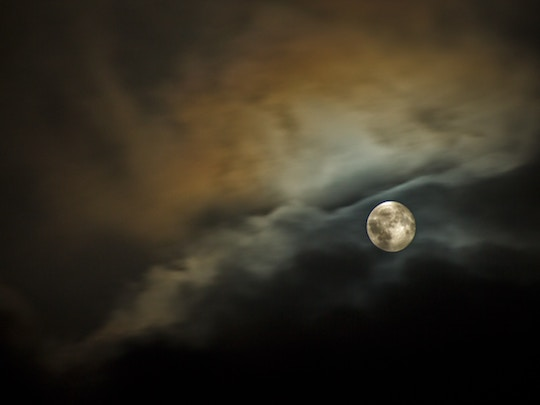 Image of a full moon in a volatile sky