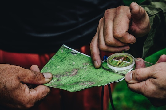 Image of hands holding a map