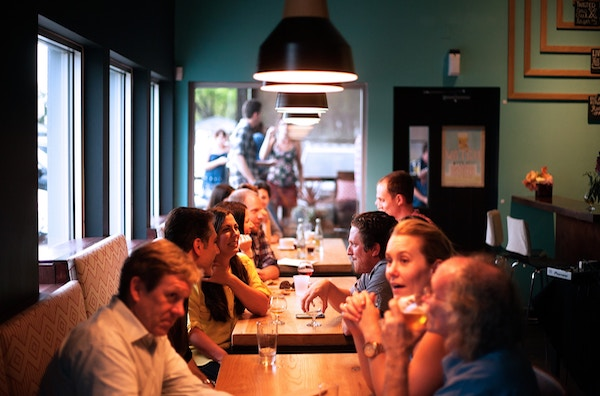 Image of people conversing at a table