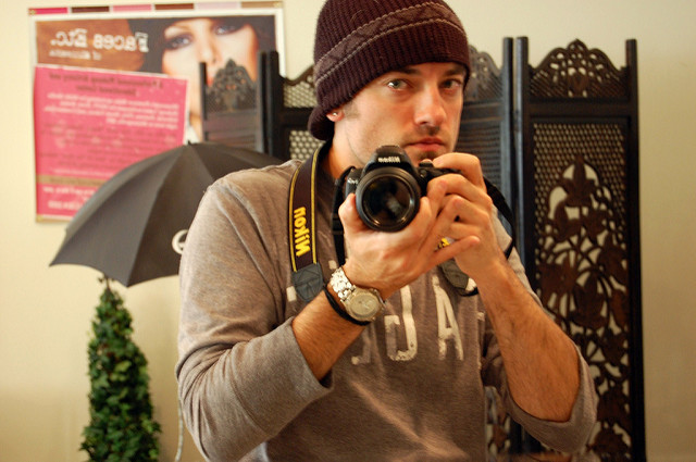 Image of a man photographing himself in a mirror