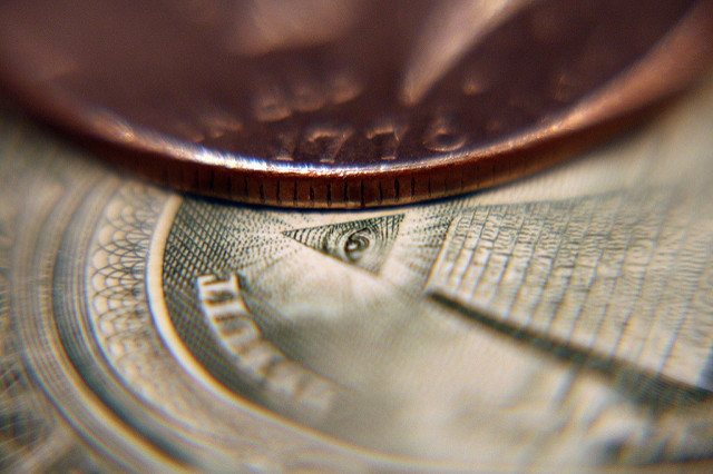 Image of coin and dollar bill