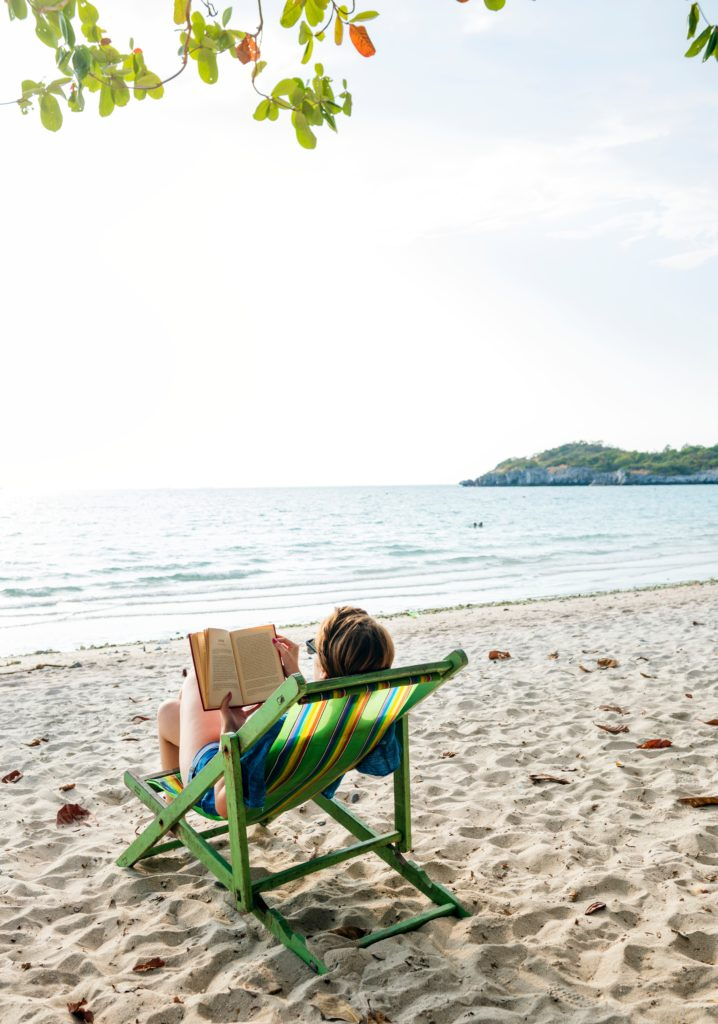 Image of woman lounging on a beach chair