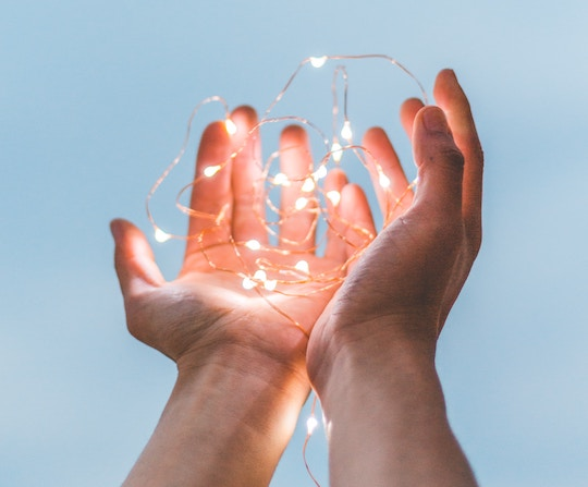 Image of hands holding light