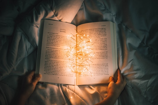 Image of a book filled with lights