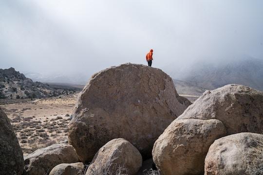 Image of a man on a boulder