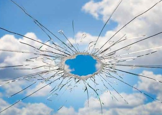Image of the sky through shattered glass