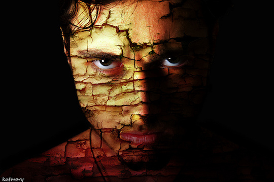 dark image of a man's fractured face