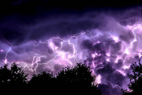 Image of a dark purple sky with lots of lightning