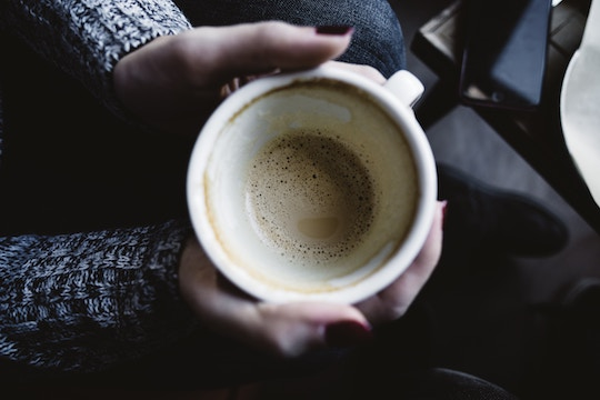 Image of hands holding a coffee cup