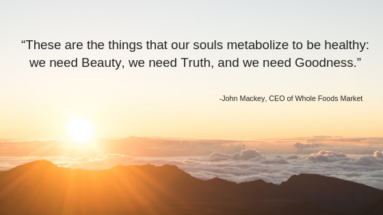 Image of sunrise over a mountain, with today's quote