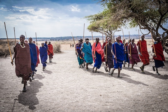 Imaage of African people in colorful dress walking