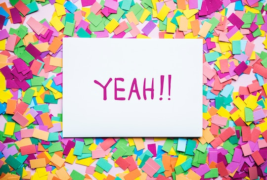 "Image of confetti topped by a sign that says, ""Yeah!"""