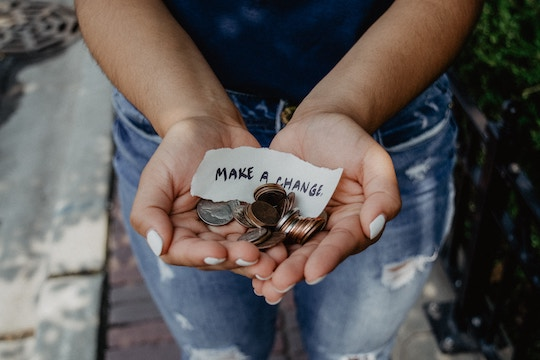 "Image of a woman holding coins and a note stating ""make a change"""