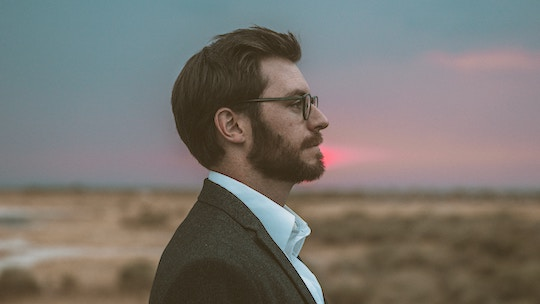 Image of a man's profile, with the sunset behind him
