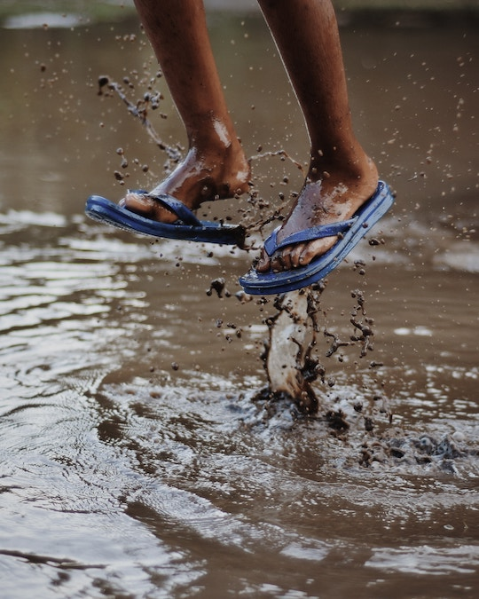 Image of feet jumping in muddy water