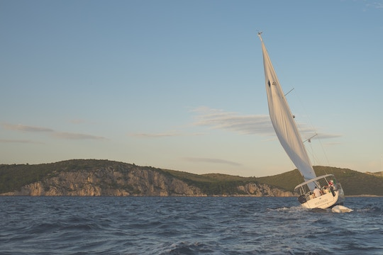 Image of a sailboat on rough waters