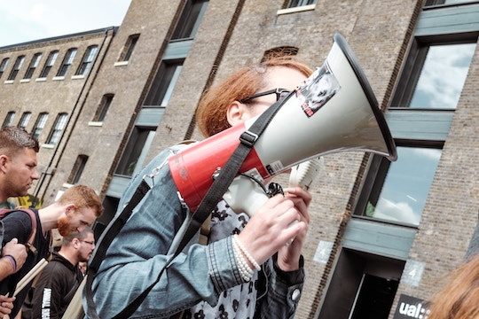 Image of a person holding a megaphone