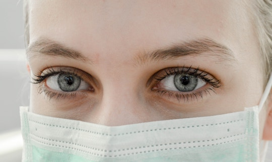 Image of a woman wearing a surgical mask
