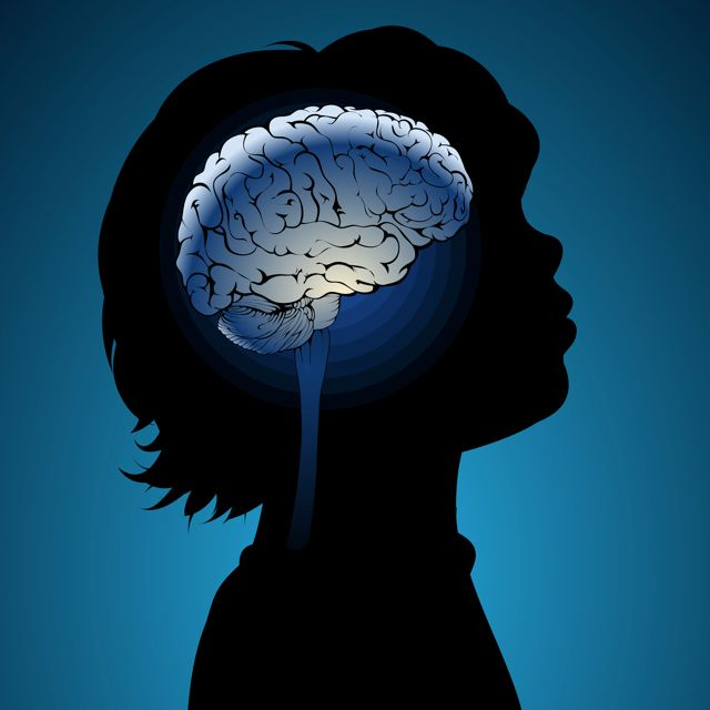 Sillhouette of a child with drawing of a brain