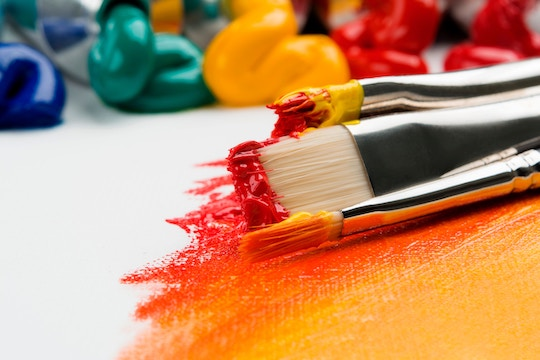 Image of paint brushes and bright colors