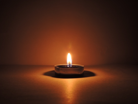 Image of a small candle burning