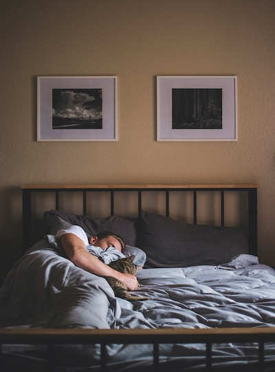 Image of a guy in bed early morning